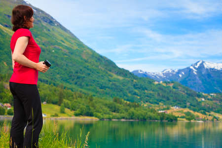 jostedalsbreen: Tourism vacation and travel. Woman tourist enjoying mountains fjords view in Jostedalsbreen National Park, Oppstryn (Stryn), Sogn og Fjordane county. Norway Scandinavia.
