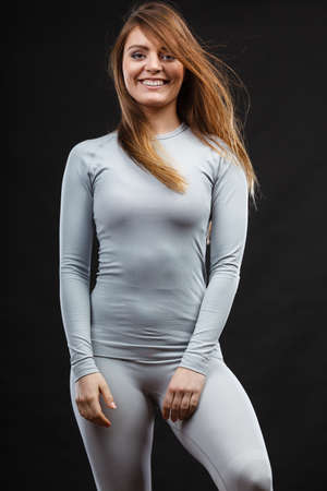 youthful: Beauty seducive shape fit body concept. Attractive girl posing. Youthful smiling lady presenting thermoactive clothing showing fitness fashion.