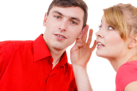 astonishment: Woman telling man some secrets, couple talking gossiping. Excited emotional girl whispering to boyfriend ear