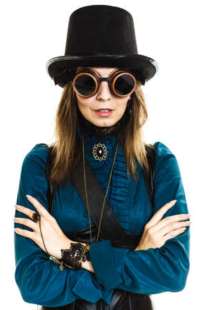steampunk goggles: Beauty and fashion - retro style. Portrait of vintage pretty woman in black hat topper and old goggles isolated on white.