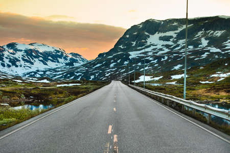 The empty road crossing the large Hardangervidda plateau in Norway.