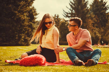 Love romance heartbreak concept. Moody girl with boyfriend in park. Lady upset on her man. Stock Photo