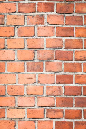 bric: .Closeup of brown red brick wall as texture or background. Architectural detail.