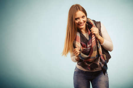 denim trousers: Fashion clothing concept. Beautiful model posing at studio. Girl is wearing denim trousers and checkered scarf. Stock Photo