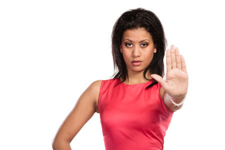 Portrait of pretty mixed race woman girl giving stop sign gesture isolated on white. Stock Photo