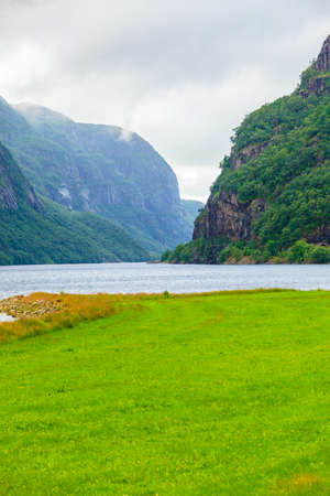 scandinavia: Tourism vacation and travel. Mountains landscape with stormy clouds and fjord in Norway Dalane region, Scandinavia. Stock Photo