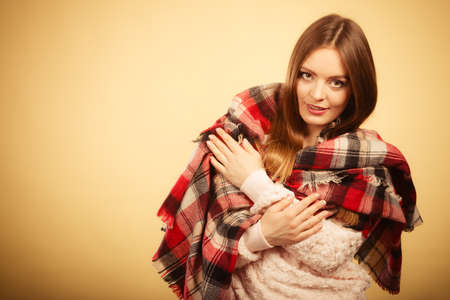 checkered scarf: Fashion warm clothing concept. Beautiful model with winter clothes. Attractive woman wearing checkered scarf and thick sweather. Stock Photo