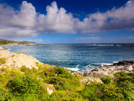 The rocky coast landscape of southern Norway with an ocean view in Rogaland county Norway. Stock Photo