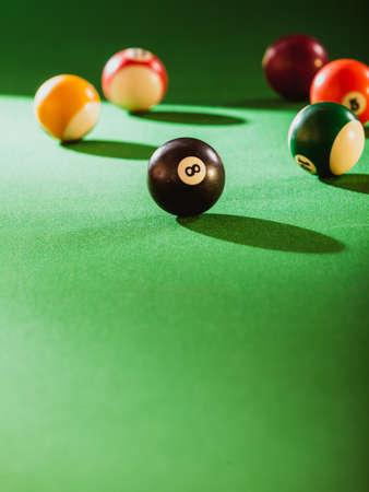 billiard: Billiard cue balls on green table. Pool game Stock Photo