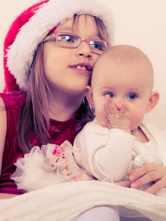 familiar: Family people siblings concept. Two beautiful sisters together. Spending christmas time with relatives. Loving familiar moments. Stock Photo