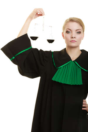 impartial: Law court concept. Woman lawyer attorney wearing classic polish black green gown holds scales. Femida - symbol sign of justice. isolated on white