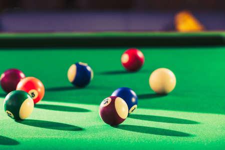 pool game: Billiard cue balls on green table. Pool game Stock Photo