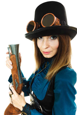 steampunk goggles: Retro old fantasy fashion style. Young pretty woman with vintage pistol isolated on white.