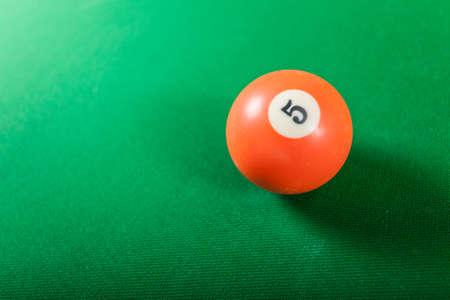 pool cue: Billiard cue ball on green table. Pool game