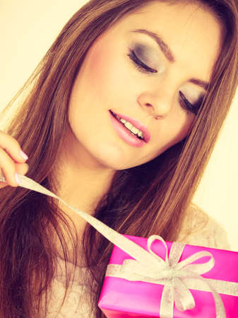 occasions: Occasions gifts people concept. Christmas xmas winter season. Lovely woman with pink rose box gift