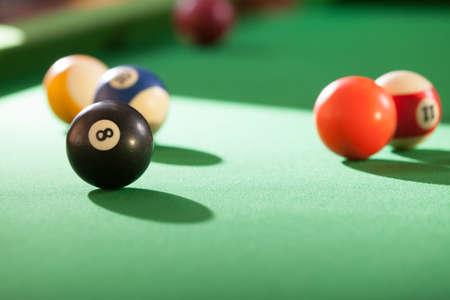 cue: Billiard cue balls on green table. Pool game Stock Photo