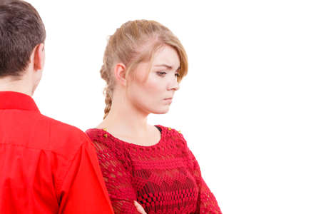 sullenly: Couple after quarrel offended sad serious. Bad relationship concept. Man and woman in disagreement.