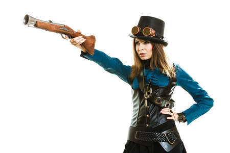 topper: Young steampunk islolated girl on white wearing fancy hat. Fantasy old fashion with stylish topper goggle and gun aiming.