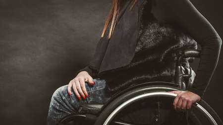 paralysis: Disease disability paralysis handicap health concept. Legs of disabled person. Crippled female sitting on wheelchair. Stock Photo