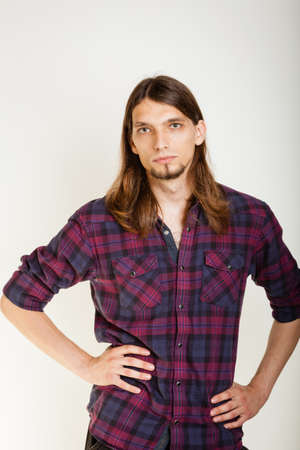 masculinity: Masculinity concept. Man in plaid shirt. Young male posing on white background.
