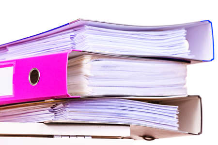 ring file: Paperwork. Stack of file folders, ring binders on office table dask. Stock Photo