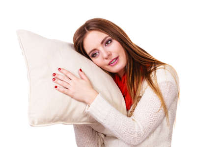 slumber: Woman sleepy tired girl holding pillow almost falling asleep. Health balance sleep deprivation concept. Female student or worker with lack of slumber on white