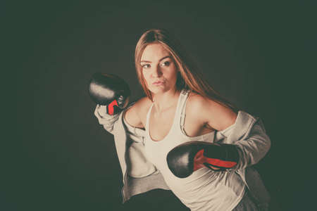 sportsmanship: Exercising prepare for fight. Sportsmanship and strong body. Energetic woman wear sportswear with exposed shoulders boxing with opponent. Sport and fitness healthy lifestyle.