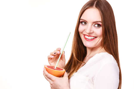 Woman attractive long hair girl colorful eyes makeup holding grapefruit citrus drinking juice from fruit. Healthy diet food. Summer vacation holidays concept. Copy space for text