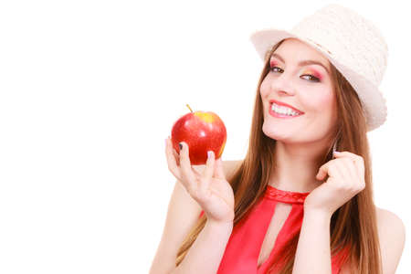 Woman charming girl long hair colorful make up wearing summer hat holds big red apple fruit. Healthy eating, vegetarian food, dieting and people concept. Stock Photo