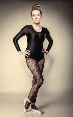 ballerina tights: Graceful beautiful woman ballet dancer full length studio shot  gray background Stock Photo