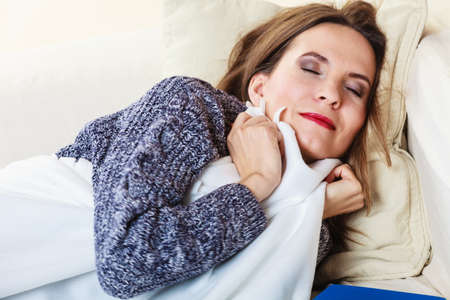power nap: Health balance sleep deprivation concept. Sleeping woman on sofa. Girl lying on couch with relaxing or taking power nap after lunch.