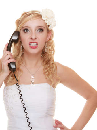 relationship difficulties: Wedding relationship difficulties. Angry woman talking on the phone. Fury bride screaming isolated on white.