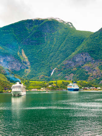 sognefjord: Tourism vacation and travel. Mountains landscape and big cruise ship on fjord Sognefjord in Flam Norway Scandinavia. Stock Photo