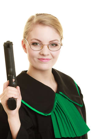 barrister: Law court or justice concept. Woman barrister lawyer wearing classic polish black green gown with weapon gun isolated on white. Crime Stock Photo