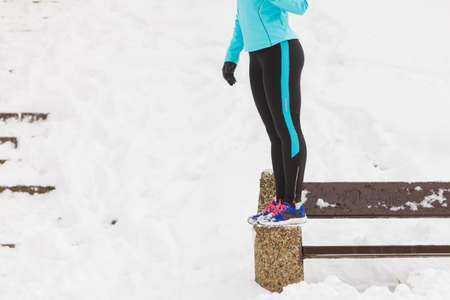 smiled: Outdoors activities people spare time concept. Young woman outside during winter. Attractive girl has blue jumper and leggins.