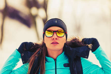despite: Girl dressed up for winter. Staying fit despite cold. Health fitness nature fashion concept.