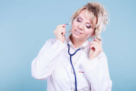 Medical examinations concept. Doctor pediatrician with stethoscope listening heart beating. Female physician holding professional medic tool.