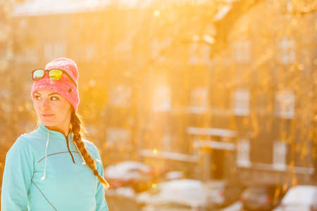 Winter sport and female fashion. Choosing good sportswear for chilling temperatures. Health fitness safety concept.