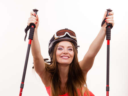 protects: Winter sport fitness concept. Fit girl with ski poles. Young woman has silver helmet with goggle which protects her head. Stock Photo