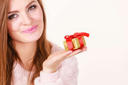 occasions: Occasions gifts people concept. Christmas xmas winter season. Lovely woman with golden box gift with red bow