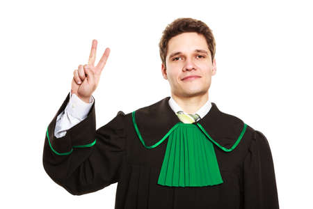 toga: Understanding and explaining sending clear message. Young lawyer wear polish toga and show hand sign. Man make gesture with hand two fingers victory sign. Stock Photo