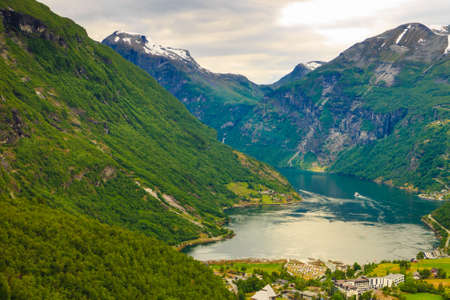 scandinavia: Tourism vacation and travel. Fantastic view on Geirangerfjord and green mountains landscape Norway Scandinavia.