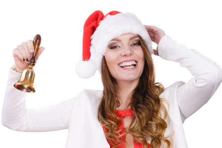 Woman wearing santa claus hat ringing a bell. Happiness holidays Christmas time concept. Studio shot isolated on white