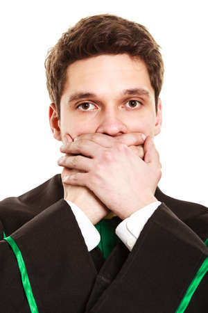 cover mouth: Emotions and communication clear message. Young guy cover mouth with hands. Man wear lawyer suit toga. Stock Photo