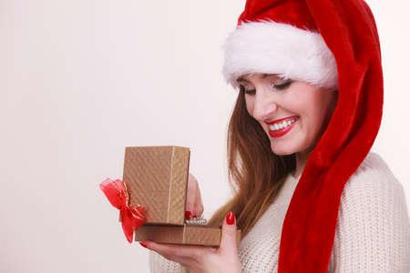Cheerful Woman Wearing Santa Claus Hat Opening Golden Gift Box ...