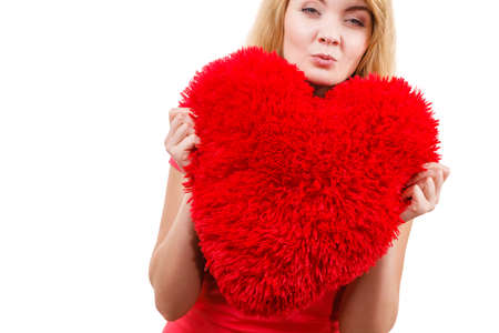 Woman blonde long hair girl holding red big heart love symbol studio shot isolated on white. Valentines day happiness concept Stock Photo