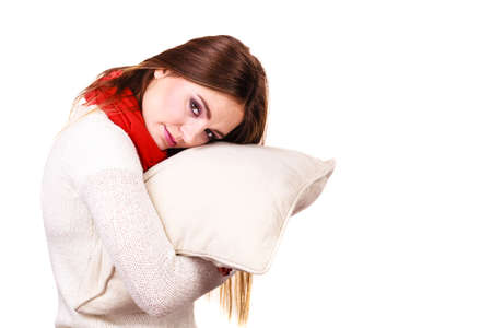 lack: Woman sleepy tired girl holding pillow almost falling asleep. Health balance sleep deprivation concept. Female student or worker with lack of slumber on white
