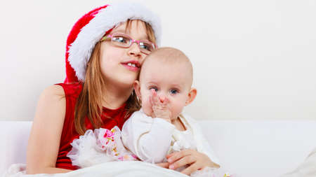 christmas spending: Family people siblings concept. Two beautiful sisters together. Spending christmas time with relatives. Loving familiar moments. Stock Photo