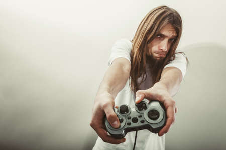 jugando videojuegos: Lifestyle of young people. Student man spending time on playing games videogames