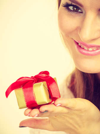 Occasions gifts people concept. Christmas xmas winter season. Lovely woman with golden box gift with red bow